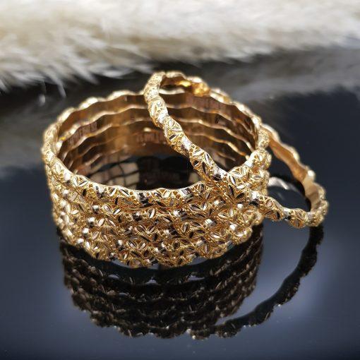 نوع جنس النگو روش ساخت ریخته ای عیار طلا 18 عیار(750) وزن محصول 7 پهنا 6میلی متر سایز کلیه سایز ها موجود مناسب برای بانوان وزن نگین ندارد رده بندی ظاهری زیبا